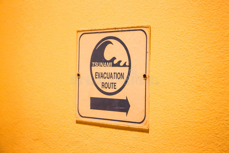 Tsunami evacuation route sign. On up stair way stock photography