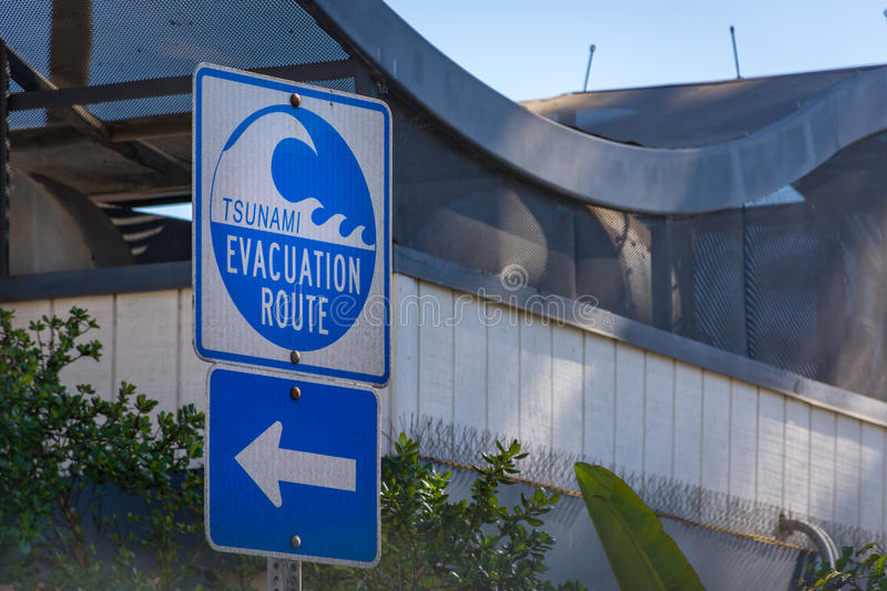 Tsunami Evacuation Route in southern California. Road sign displays the Tsunami Evacuation Route near the beach in the event of earthquake stock image