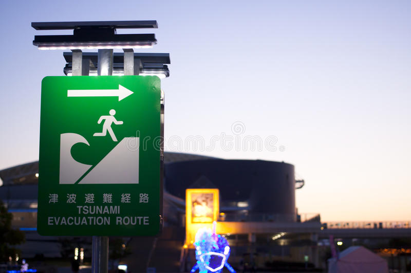 Tsunami evacuation route symbol. Tsunami evacuation route signs on one of the beaches in Japan royalty free stock images