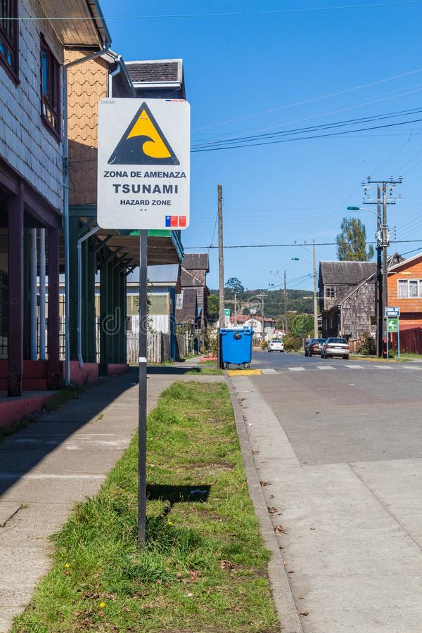 Tsunami Hazard Zone Sign in Curaco de Velez village, Chi stock image