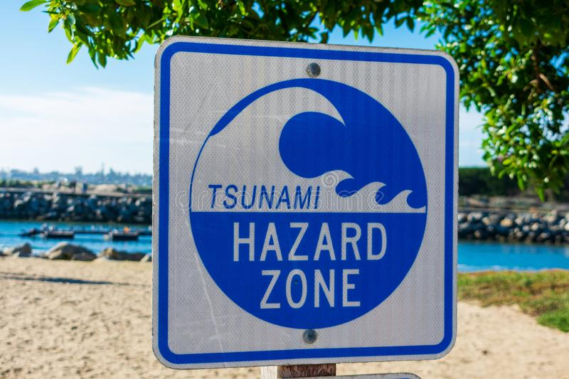Tsunami Hazard Zone warning sign on the Pacific Ocean coast warns public about possible danger after earthquake stock photos