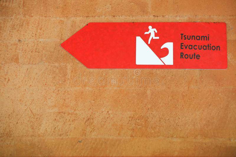 Tsunami red warning sign on the wall. Danger sign royalty free stock photography