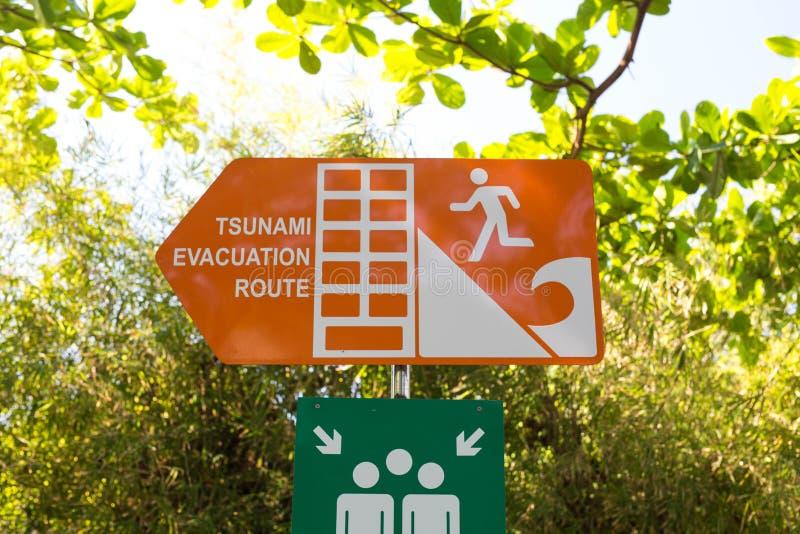 Tsunami roadsign pointing towards the stunami evacuation route, escape plam in Indonesia Bali. Orange stock images