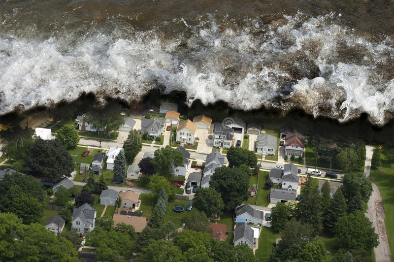 Tsunami Tidal Wave Natural Disaster. Artist rendition of a tsunami or giant tidal wave crashing into a neighborhood. The ocean comes crashing into a residential royalty free stock image