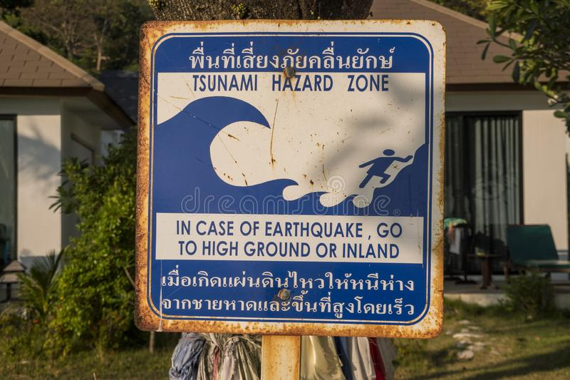 Tsunami warning sign at a beach in southern Thailand. Thai language instructions telling people to run to high ground stock photography
