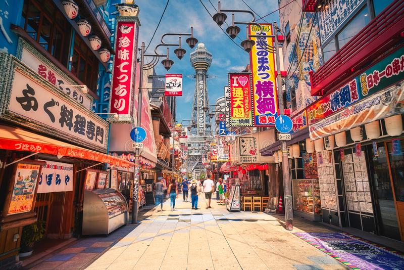 Tsutenkaku tower is a famous landmark of Osaka, Japan. Osaka, Japan - July 22, 2018: Tsutenkaku tower is a famous landmark of Osaka, Japan and advertises stock photo