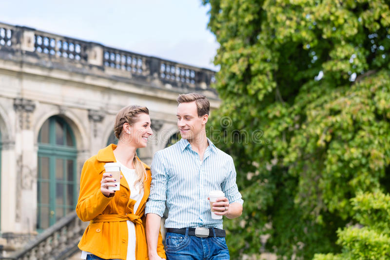TTourist couple in Dresden having walk at Zwinger stock images