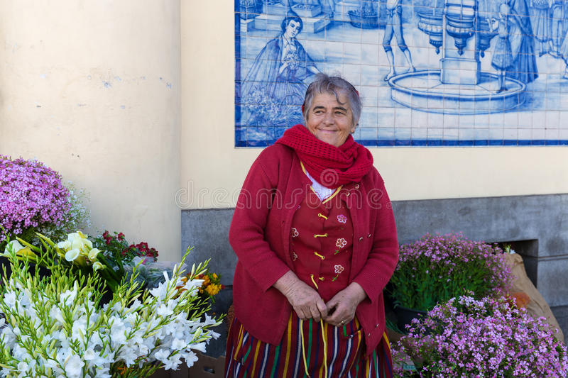 Ttraditional woman sells flowers at a market of Funchal, Portugal royalty free stock photography