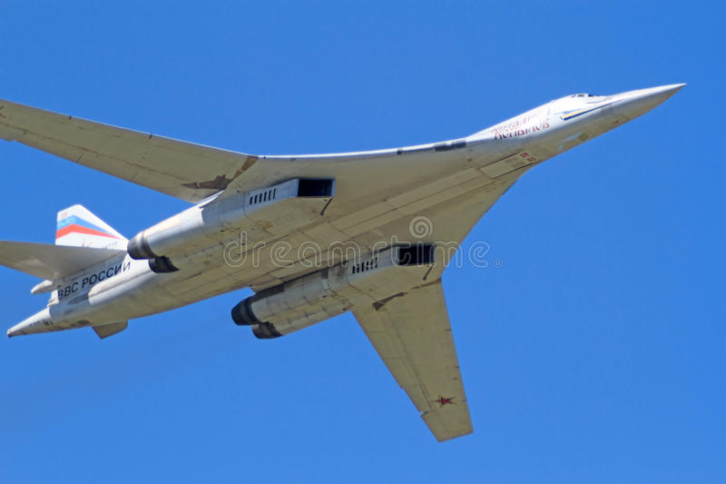 Tu-160 in the blue sky. Tambov, Russia - May 31, 2014: Traditional air show in Tambov. Tu-160 (NATO reporting name Blackjack) - supersonic strategic bomber with stock photos