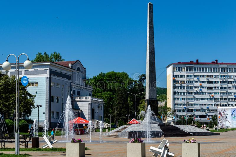 Granite stele with fountains on pedestrian-only street, on square of October Revolution. Tuapse. Tuapse, Russia - May 16, 2019: Granite stele with fountains on royalty free stock photo