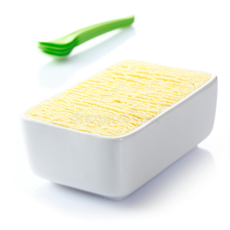 Tub of frozen vanilla icecream. Ceramic tub filled with textured delicious frozen vanilla icecream ready to be served for dessert at a summertime meal royalty free stock photo