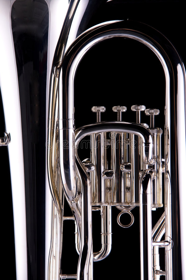 Tuba de plata en negro foto de archivo libre de regalías