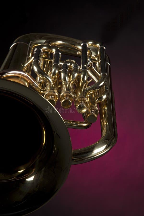 Tuba Euphonium Isolated On Red stock photos