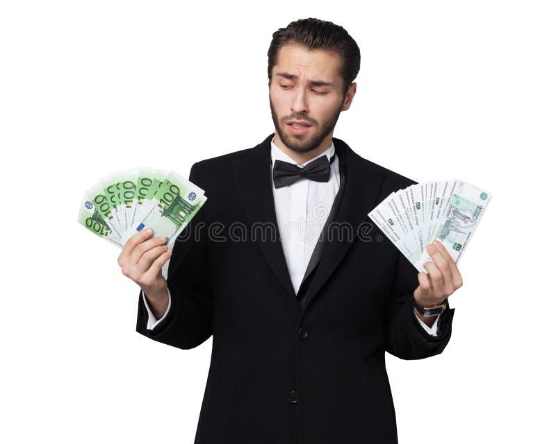 Tubarão do capitalismo Homem de negócios masculino novo que aprecia o euro- dinheiro fotos de stock