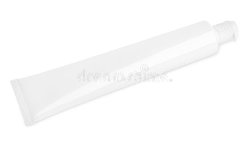Tube de pâte dentifrice sur le blanc image stock