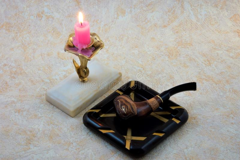 Pipe with Smoking tobacco ornament candle ashtray stock images