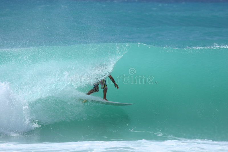 Tube ride 3. Surfer in a clean tube royalty free stock photos
