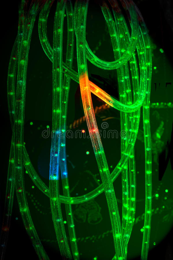 Tube rope lights. Detail of a flexible green tube rope lights switched on in the dark royalty free stock photography
