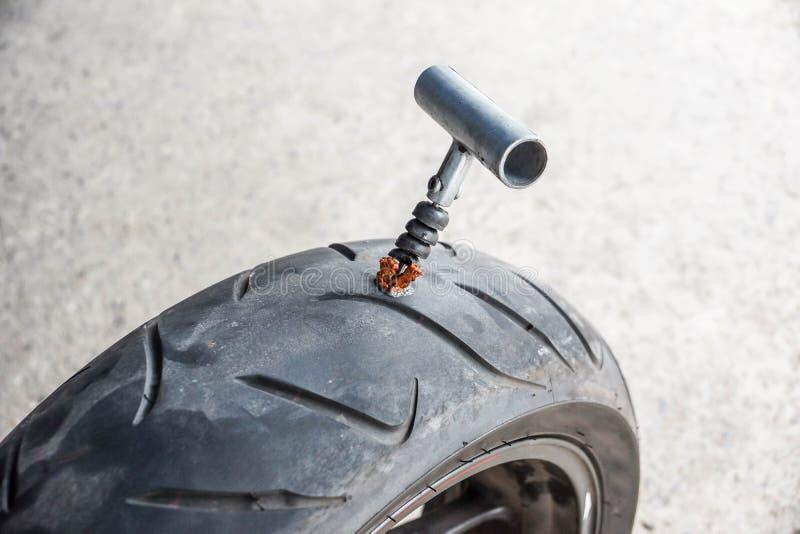 Tubeless Tire Puncture Repair Kit. For Car and Bike stock photos
