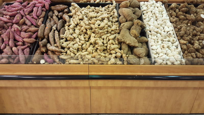 Tuber vegetables. Potatoes and roots. Grocery stock images