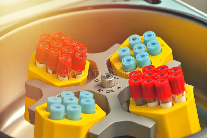 Tubes of blood sample for testing in a spin. Medical equipment.  stock photos