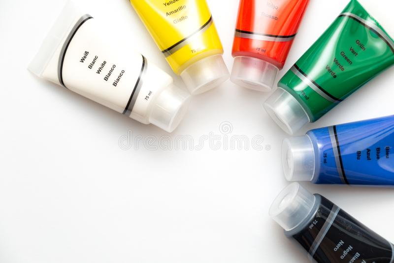 Tubes of colorful acrylic paints stock images