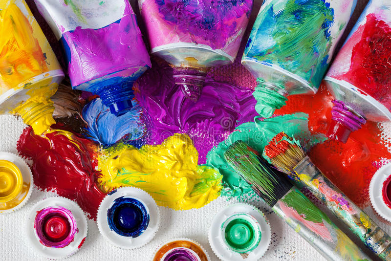 Tubes of oil paint, palette and artist paintbrushes royalty free stock photo