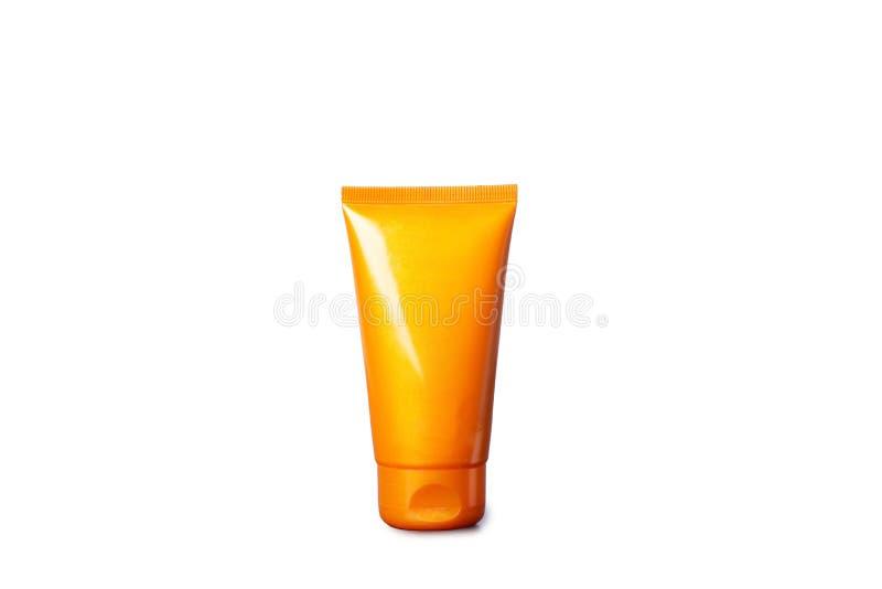Tubi con crema e la crema-mascherina prendenti il sole immagini stock