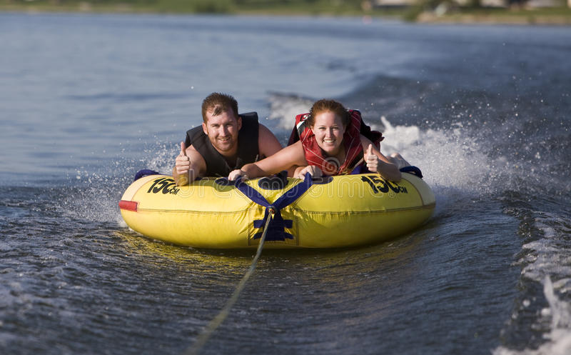 Tubing. Fun on a lake royalty free stock photos