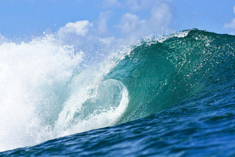 Tubing Blue Wave in Honolulu, Hawaii royalty free stock images