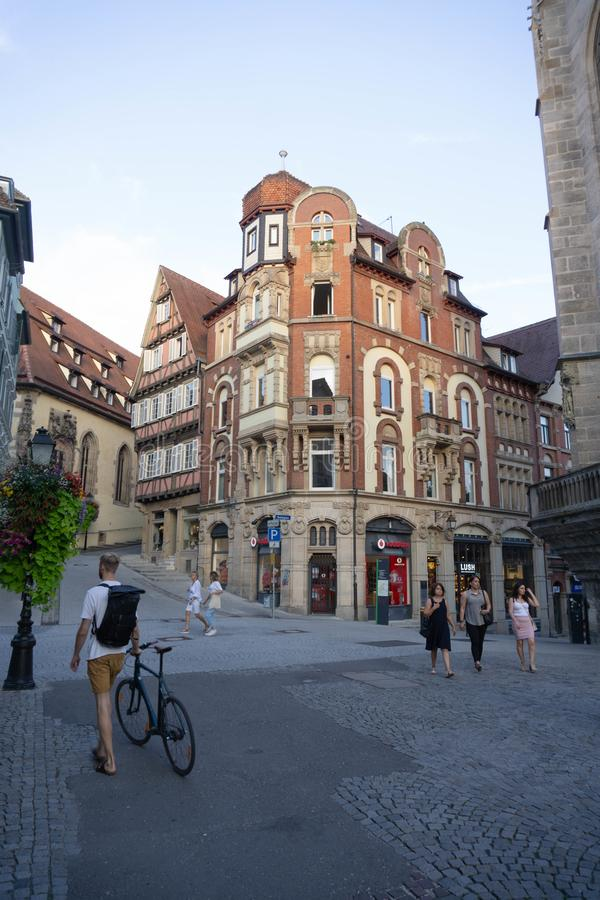 TUBINGEN/GERMANY-JULY 31 2018: a classic European-style building at a crossroads, is vodafone`s shop in Tubingen royalty free stock photos