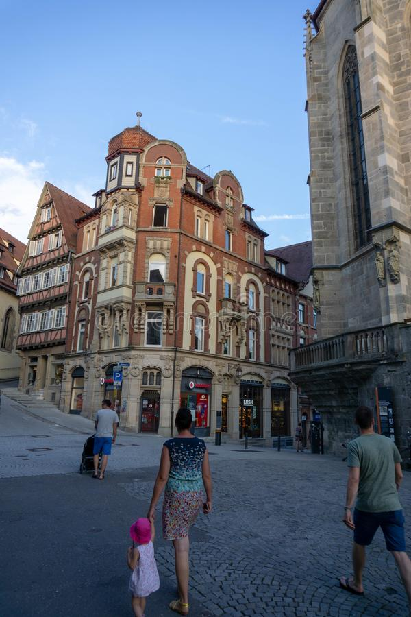 TUBINGEN/GERMANY-JULY 31 2018: a classic European-style building at a crossroads, is vodafone`s shop in Tubingen royalty free stock photo