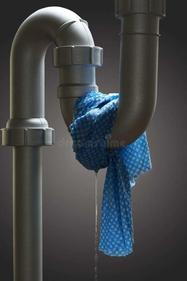 Tubo colante con l'asciugamano fotografia stock libera da diritti
