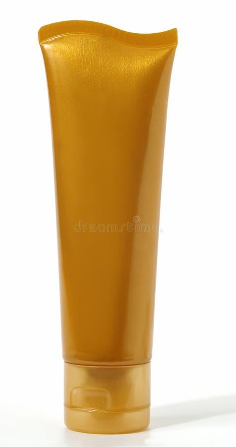 Tubo cosmetico arancione in bianco fotografie stock libere da diritti