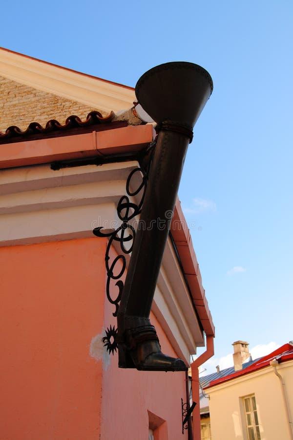 Tubo de desagüe en forma de una bota de vaquero foto de archivo libre de regalías
