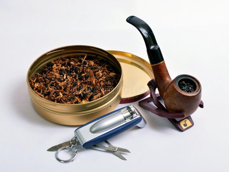 Tubo di fumo e tabacco aromatico fotografie stock