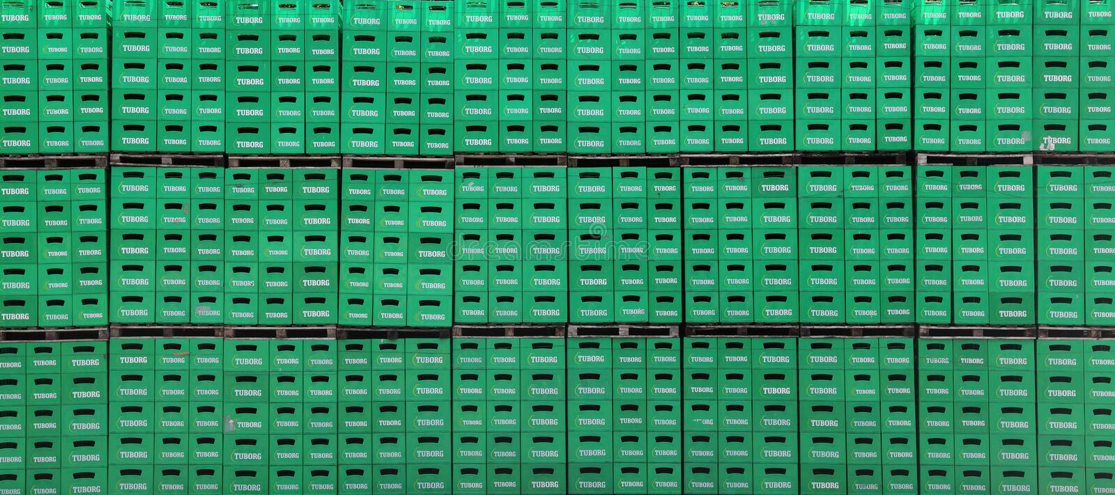 Tuborg beer package in factory. CELAREVO, SERBIA - JUNE 11. 2017. Carlsberg Serbia brewery, heap of green crates for Tuborg beer at factory large warehouse stock images