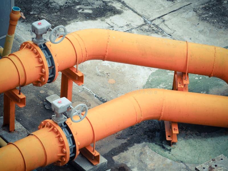 Tubos de agua anaranjados fotografía de archivo