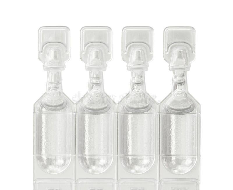 Tubos de ensaio das gotas de olho do lubrificante fotografia de stock royalty free