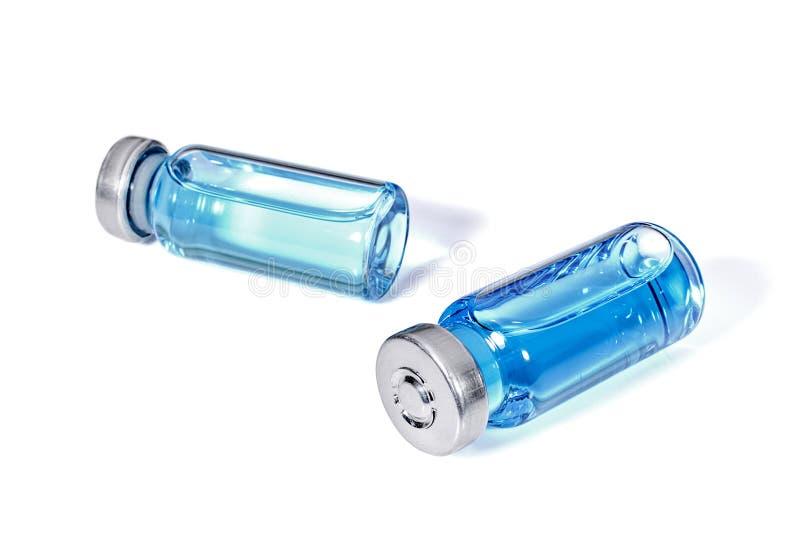 Tubos de ensaio de Medicals com vacina azul foto de stock