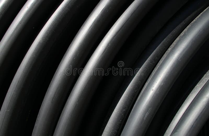Tubos plásticos negros imágenes de archivo libres de regalías