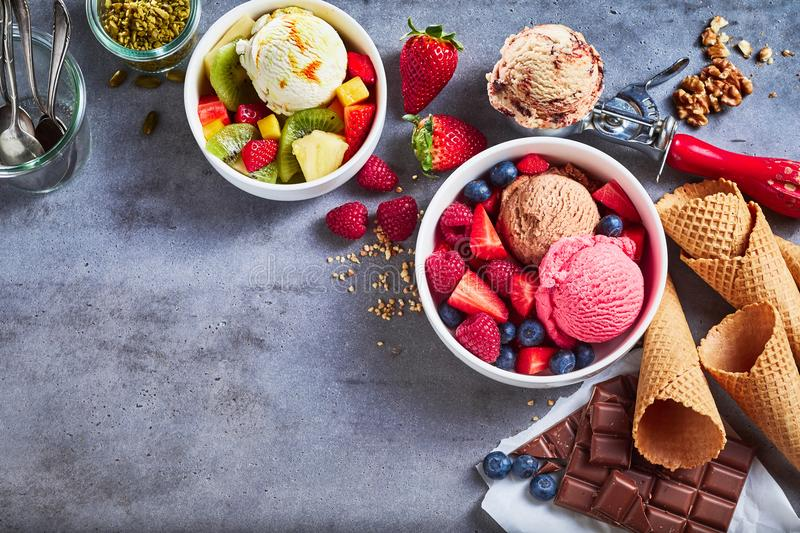 Tubs of fresh fruit with ice cream and ingredients royalty free stock images