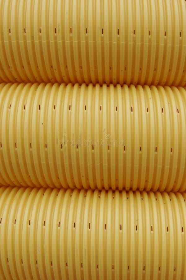 Tubulação amarela imagem de stock