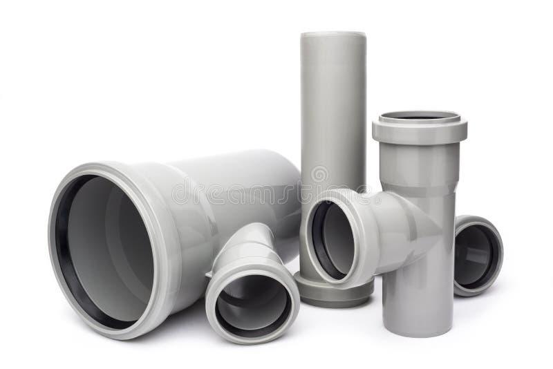 Tubulação plástica cinzenta no fundo branco imagens de stock