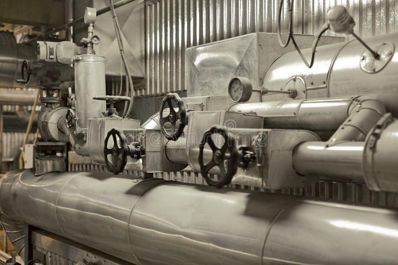 Tubulações de um central elétrica térmico fotografia de stock royalty free
