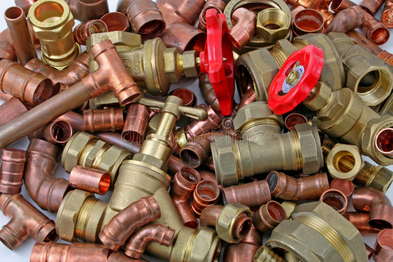 Tubulações e encaixes do ` s do encanador imagem de stock