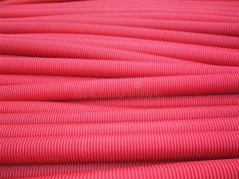 Tubulações vermelhas do pvc fotos de stock royalty free