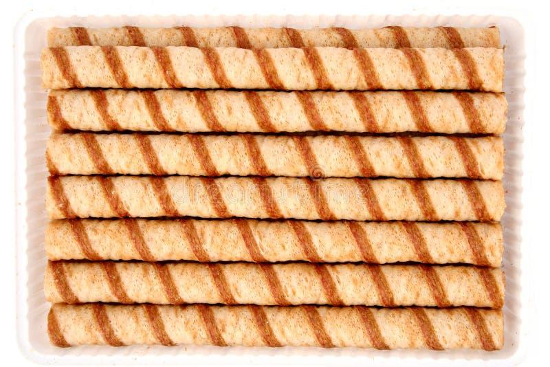Tubules rayés de disque avec de la crème de chocolat images stock