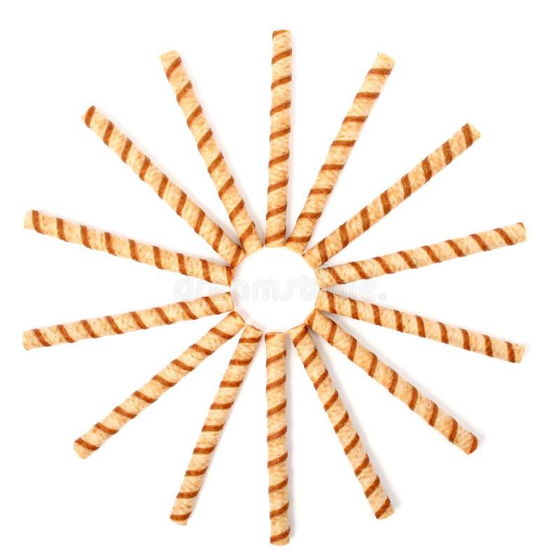 Tubules rayés de disque avec de la crème de chocolat, d'isolement image libre de droits