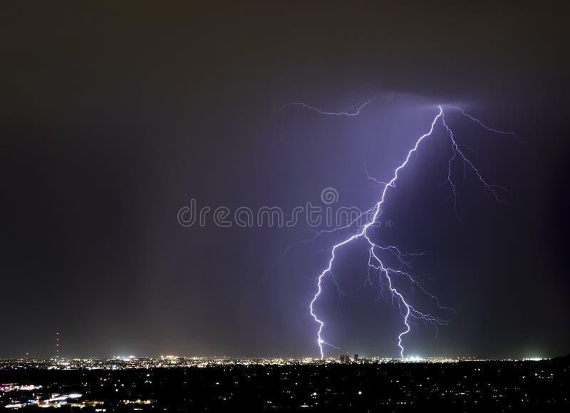 Tucson Forked Lightning. Lightning forks over downtown Tucson royalty free stock image